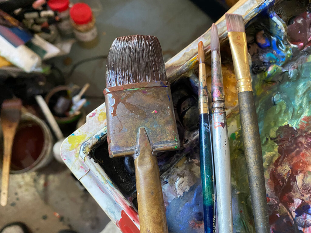 Watercolor brushes in my studio, resting on my paints palette